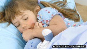_70067996_girl_sleeping_with_a_cuddly_toy-spl-1