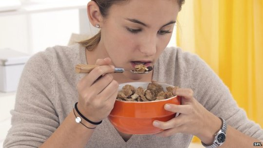 _72066609_c0134899-student_eating_cereal-spl12528627